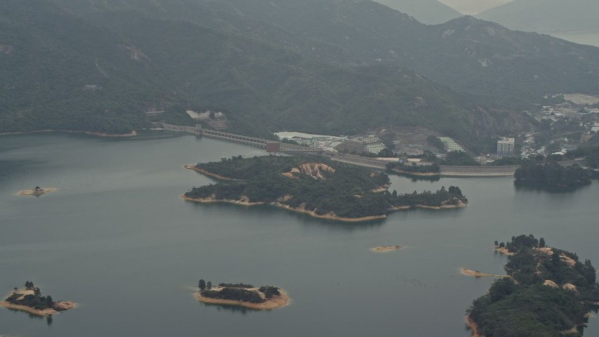 Tai Lam Chung Reservoir and dam in New Territories, Hong Kong, China Aerial Stock Footage DCA02_065 | Axiom Images