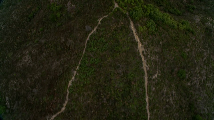 4K stock footage aerial video of a bird's eye view of dirt roads on a mountain peak in New Territories, Hong Kong, China Aerial Stock Footage | DCA02_067