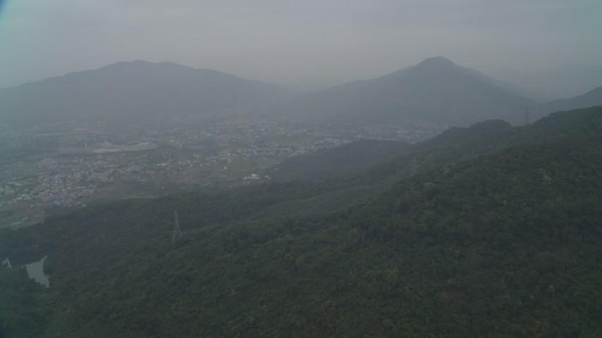 4K stock footage aerial video of Shek Kong neighborhoods and mountain peaks, New Territories, Hong Kong, China Aerial Stock Footage   DCA02_069