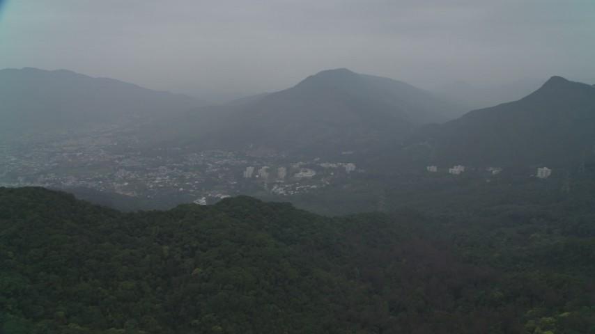 4K stock footage aerial video flyby peak to reveal Shek Kong neighborhoods, New Territories, Hong Kong, China Aerial Stock Footage | DCA02_070
