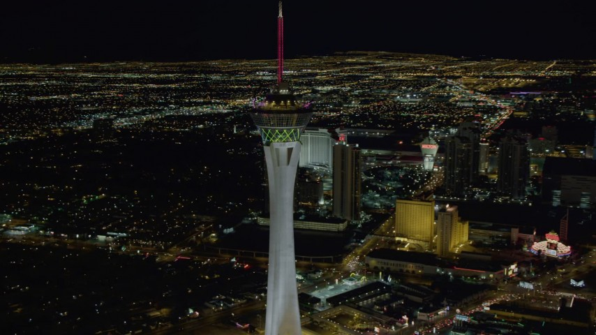 4K stock footage aerial video of orbiting top of Stratosphere with city sprawl in background, Las Vegas, Nevada Night Aerial Stock Footage | DCA03_006
