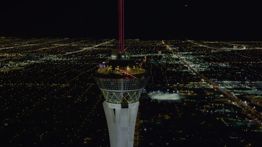 4K stock footage aerial video of orbiting top of Stratosphere with city sprawl in background, Las Vegas, Nevada Night Aerial Stock Footage | DCA03_007