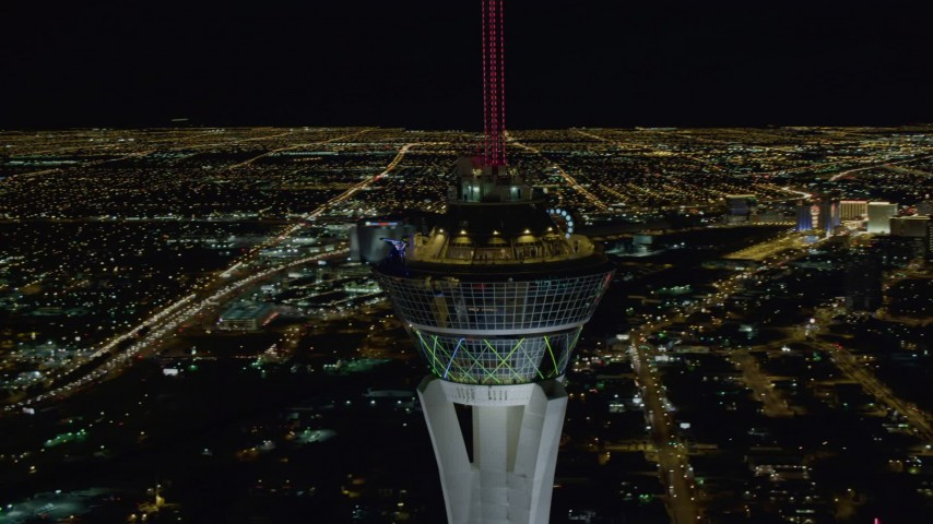 4K stock footage aerial video of orbiting top of Stratosphere with city sprawl in background, Las Vegas, Nevada Night Aerial Stock Footage | DCA03_008