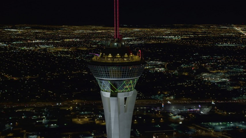 4K stock footage aerial video of orbiting top of Stratosphere with city sprawl in background, Las Vegas, Nevada Night Aerial Stock Footage | DCA03_009