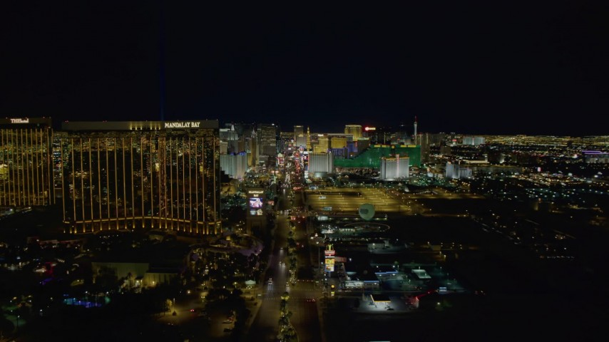 4K stock footage aerial video of Las Vegas Boulevard to Mandalay Bay, hotels and casinos in background, Las Vegas, Nevada Night Aerial Stock Footage | DCA03_013