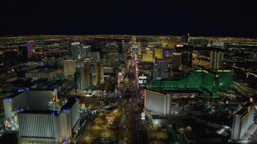 4K stock footage aerial video of Las Vegas Boulevard past Excalibur, New York New York, MGM Grand, Las Vegas, Nevada Night Aerial Stock Footage | DCA03_015