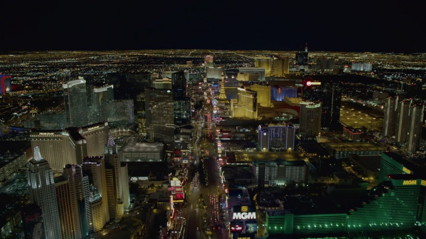 4K stock footage aerial video of Las Vegas Boulevard between New York New York and MGM Grand to Monte Carlo, Las Vegas, Nevada Night Aerial Stock Footage | DCA03_016