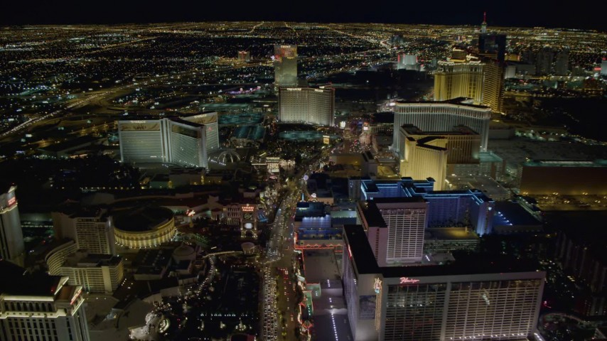 4K stock footage aerial video of Las Vegas Boulevard between Caesar's Palace and Flamingo, toward The Mirage and Treasure Island, Las Vegas, Nevada Night Aerial Stock Footage | DCA03_019