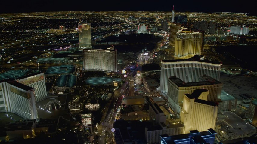 4K stock footage aerial video of Las Vegas Boulevard between The Mirage and The Venetian, toward Treasure Island, Las Vegas, Nevada Night Aerial Stock Footage | DCA03_020