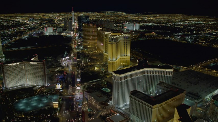 4K stock footage aerial video of panning across Las Vegas Boulevard, from Treasure Island to the Venetian, Las Vegas, Nevada, Night Aerial Stock Footage | DCA03_021