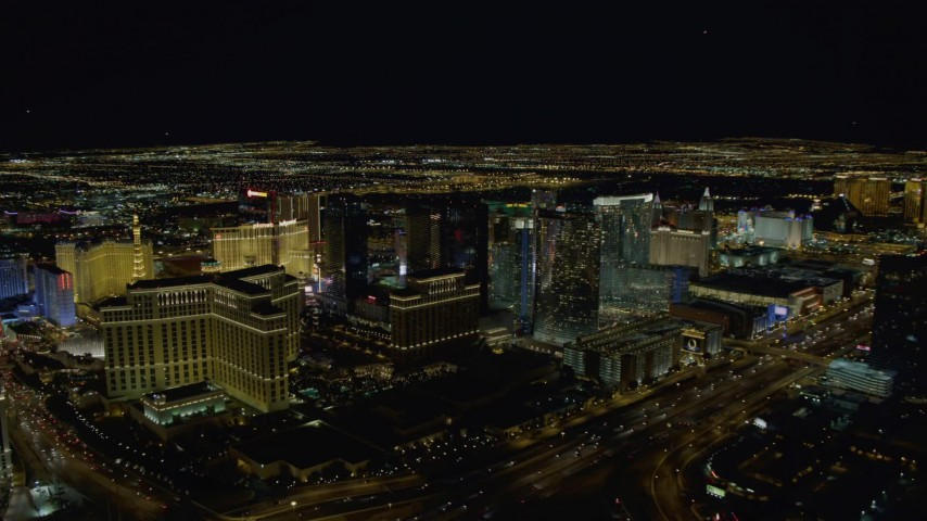 4K aerial video of the back of The Bellagio, Aria Resort, Paris, Planet Hollywood, Las Vegas, Nevada Night Aerial Stock Footage | DCA03_022