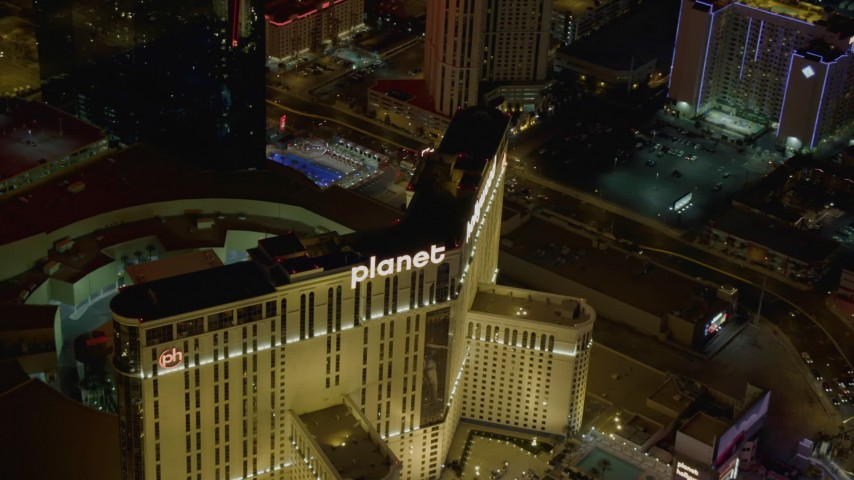 4K stock footage aerial video of orbiting Planet Hollywood and street with traffic, Las Vegas, Nevada Night Aerial Stock Footage | DCA03_044