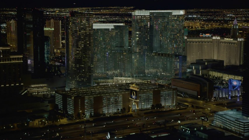 4K stock footage aerial video of descending toward parking garage near Aria Resort, Las Vegas, Nevada Night Aerial Stock Footage | DCA03_048