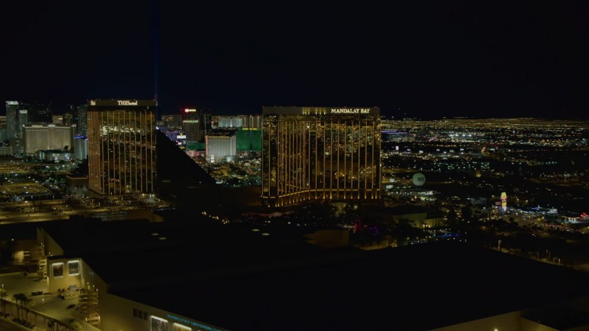 4K aerial video of The Hotel and Mandalay Bay Resort, revealing Luxor Hotel, Las Vegas, Nevada Night Aerial Stock Footage | DCA03_052