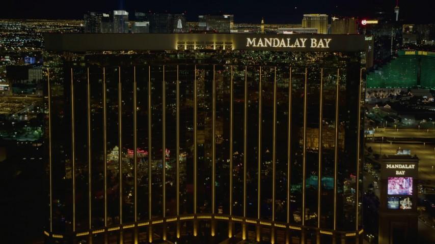 4K stock footage aerial video of approaching Mandalay Bay, Las Vegas, Nevada Night Aerial Stock Footage | DCA03_054