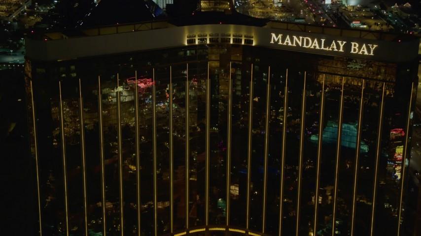 4K stock footage aerial video of slowly ascending by Mandalay Bay, Las Vegas, Nevada Night Aerial Stock Footage | DCA03_055