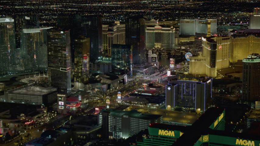 4K aerial video of flying toward Planet Hollywood, following Las Vegas Blvd, Las Vegas, Nevada Night Aerial Stock Footage | DCA03_058