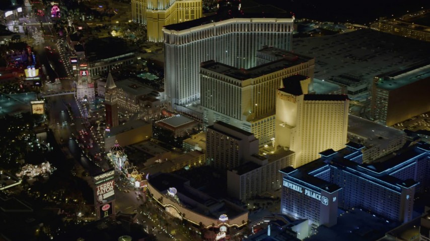 4K stock footage aerial video of panning across Imperial Palace, Harrah's, The Venetian, Las Vegas, Nevada Night Aerial Stock Footage | DCA03_063