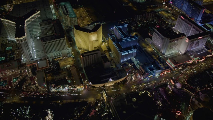 4K aerial video of flying by The Venetian, Harrah's, Imperial Palace, Las Vegas, Nevada Night Aerial Stock Footage | DCA03_069