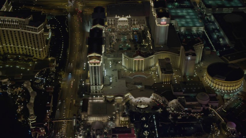 4K aerial video of flying by The Bellagio, Caesar's Palace, Las Vegas, Nevada Night Aerial Stock Footage | DCA03_077