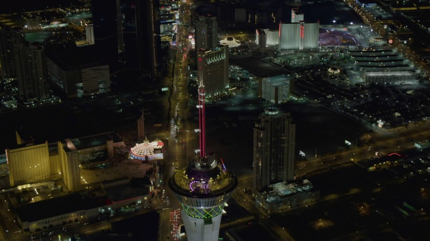 4K stock footage aerial video of orbiting Stratosphere, revealing Las Vegas Boulevard, hotels on Strip, Las Vegas, Nevada Night Aerial Stock Footage | DCA03_084
