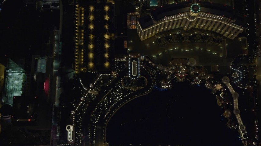 4K aerial video of bird's eye view of The Bellagio, The Bellagio Fountain, Caesar's Palace, Las Vegas, Nevada Night Aerial Stock Footage | DCA03_118
