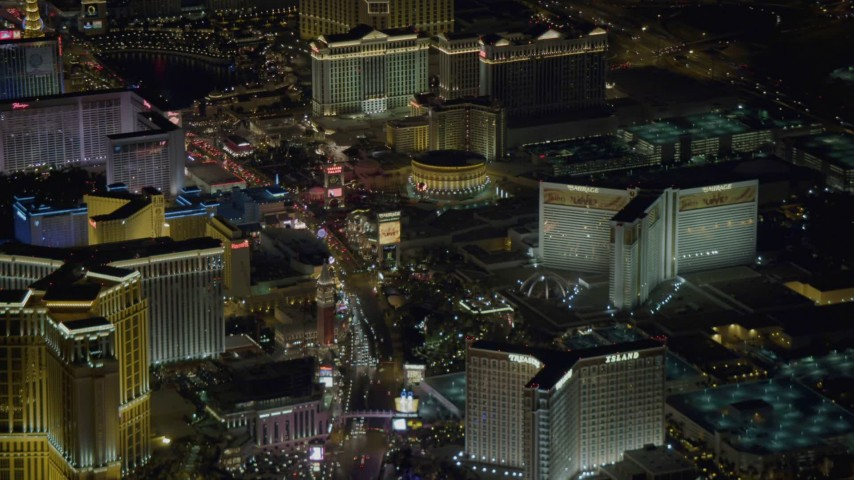4K stock footage aerial video tilt to reveal hotels along Las Vegas Strip, Nevada Night Aerial Stock Footage | DCA03_122