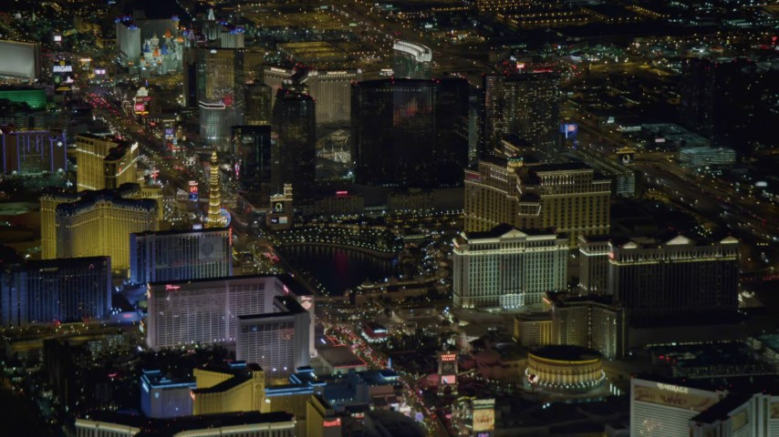 4K stock footage aerial video tilt up on Las Vegas Boulevard, revealing hotels on Las Vegas Strip, Nevada Night Aerial Stock Footage DCA03_123