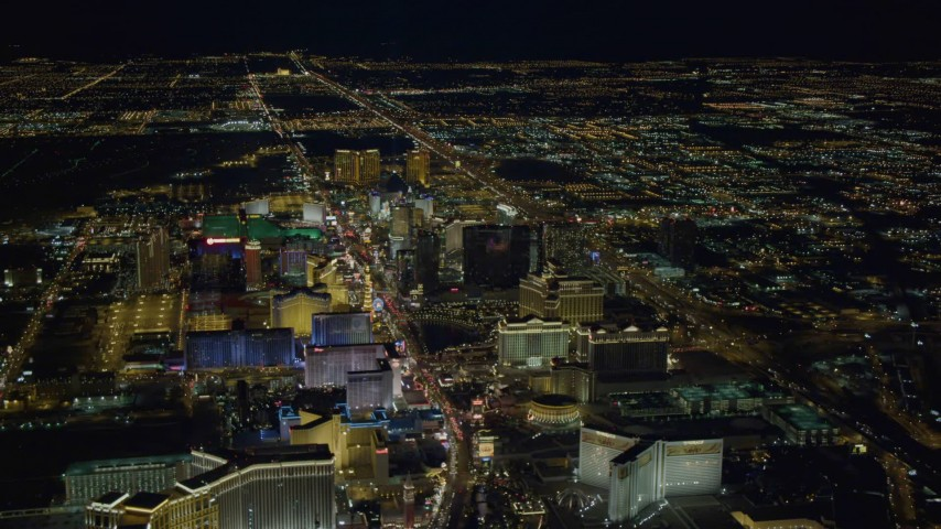 4K stock footage aerial video of hotels on Las Vegas Strip, descending toward Las Vegas Boulevard, Nevada Night Aerial Stock Footage DCA03_124