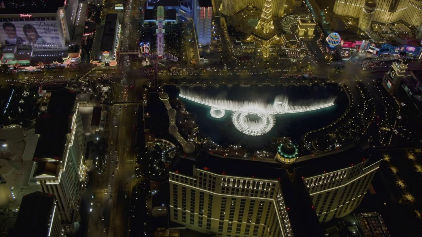 4K aerial video of orbiting the water show at The Bellagio, Las Vegas, Nevada Night Aerial Stock Footage | DCA03_132