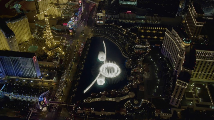 4K stock footage aerial video of orbiting the water show at The Bellagio, Las Vegas, Nevada Night Aerial Stock Footage | DCA03_133