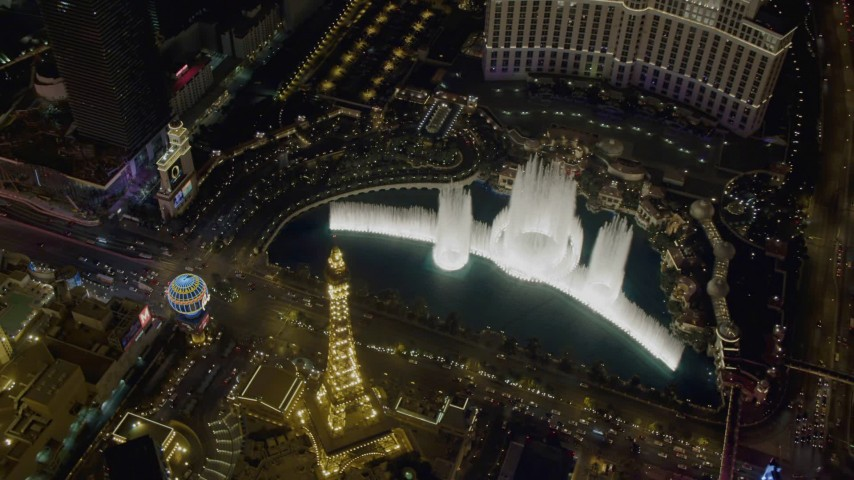 4K aerial video of orbiting The Bellagio fountain at the end of the show, Las Vegas, Nevada Night Aerial Stock Footage | DCA03_134