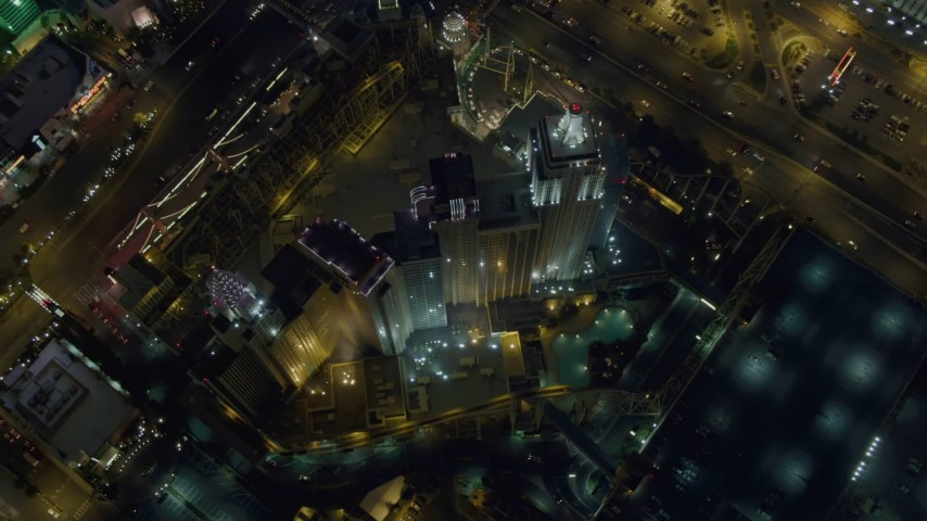4K stock footage aerial video of flying away from New York New York Hotel and Casino, Las Vegas, Nevada Night Aerial Stock Footage | DCA03_145