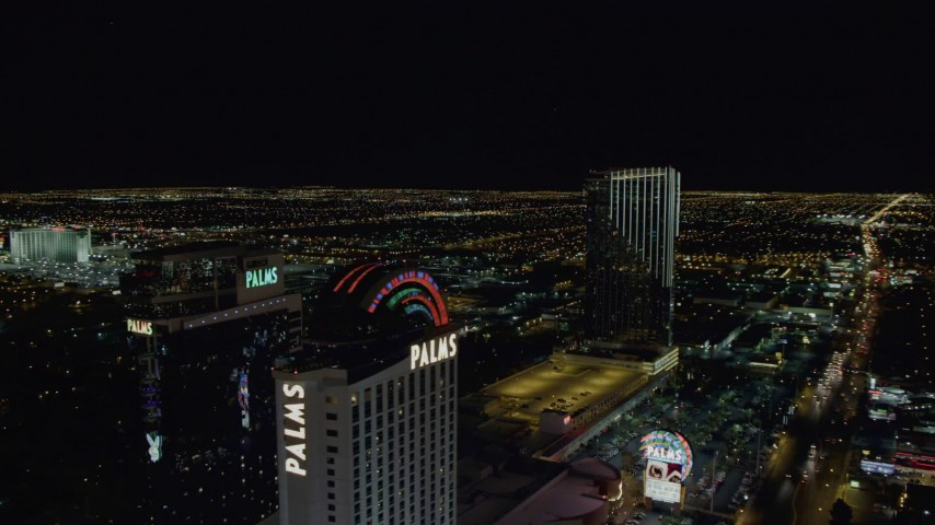 4K stock footage aerial video of flying by Palms Casino toward Palms Place Hotel and Spa, Las Vegas, Nevada Night Aerial Stock Footage DCA03_154 | Axiom Images