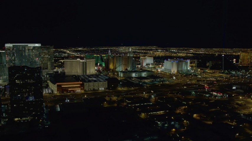 4K aerial video of approaching hotels on Las Vegas Strip, Nevada Night Aerial Stock Footage | DCA03_158