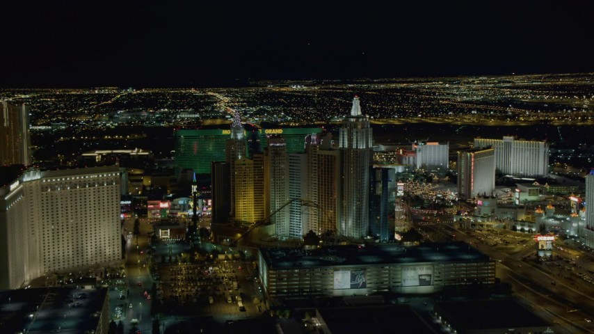 4K stock footage aerial video of approaching New York New York Hotel and Casino, Las Vegas, Nevada Night Aerial Stock Footage | DCA03_159