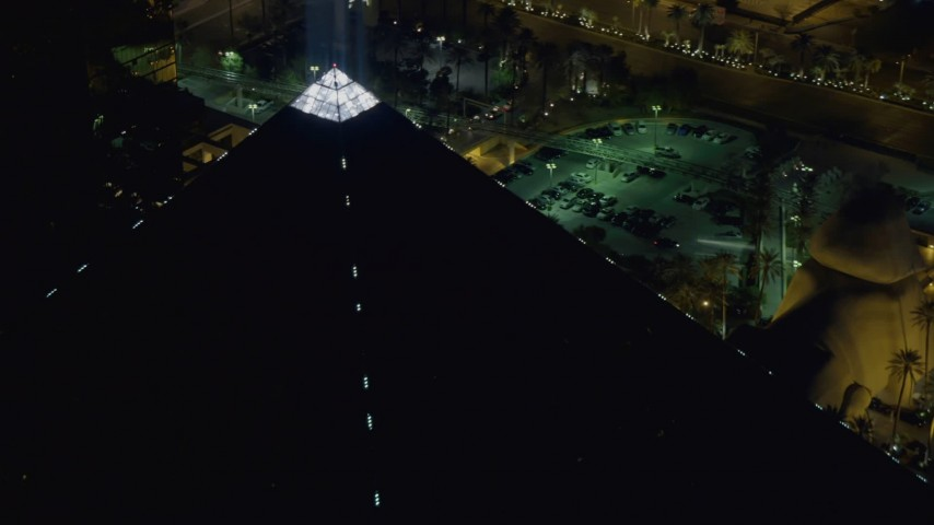 4K stock footage aerial video of flying by top of Luxor Hotel and Casino,  Las Vegas, Nevada Night