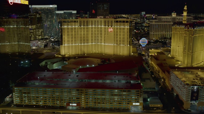 4K stock footage aerial video of flying behind Planet Hollywood, Paris and Bally's, Las Vegas, Nevada Night Aerial Stock Footage | DCA03_168