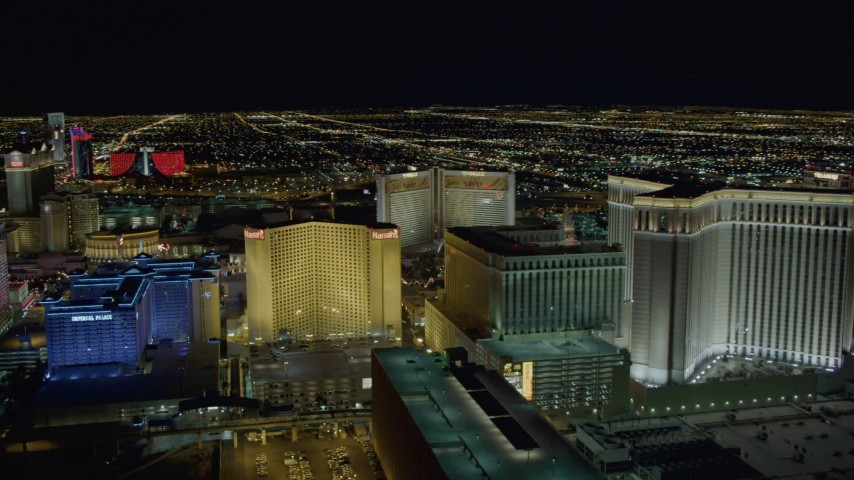 4K stock footage aerial video of flying behind Imperial Palace and Harrah's, Las Vegas, Nevada Night Aerial Stock Footage | DCA03_170