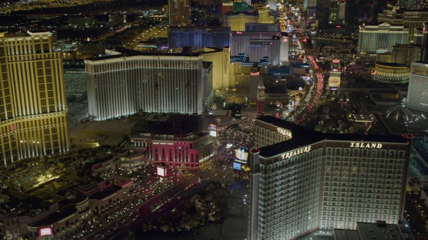 4K stock footage aerial video of hotels along Las Vegas Boulevard, including Treasure Island, Nevada Night Aerial Stock Footage | DCA03_174