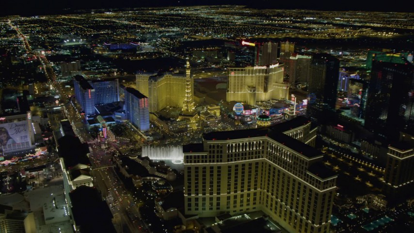 4K aerial video of panning across hotels on Las Vegas Strip, Nevada Night Aerial Stock Footage | DCA03_193