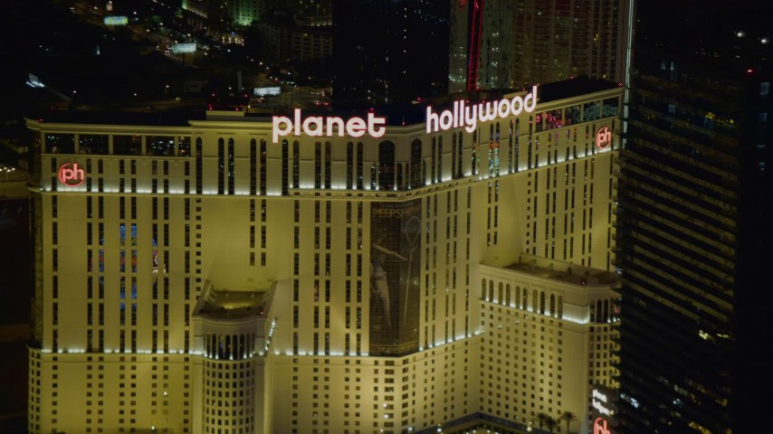 4K stock footage aerial video of zooming closer to Planet Hollywood Resort and Casino, Las Vegas, Nevada Night Aerial Stock Footage | DCA03_198