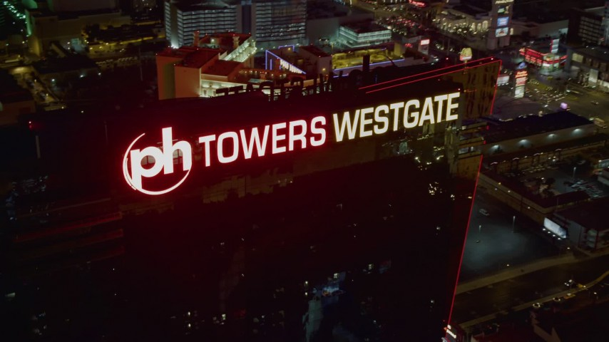 4K stock footage aerial video approach and orbit Planet Hollywood Towers Westgate, Las Vegas, Nevada Night Aerial Stock Footage DCA03_204 | Axiom Images