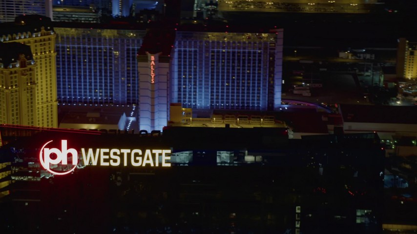 4K stock footage aerial video of approaching Planet Hollywood Towers Westgate, Las Vegas, Nevada Night Aerial Stock Footage | DCA03_205