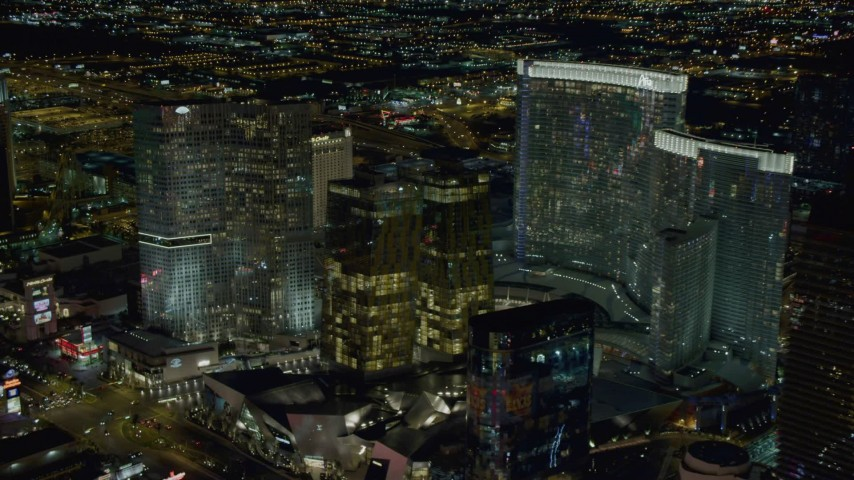 4K stock footage aerial video of approaching Aria, Veer Towers, Mandarin Oriental, Las Vegas, Nevada Night Aerial Stock Footage | DCA03_211