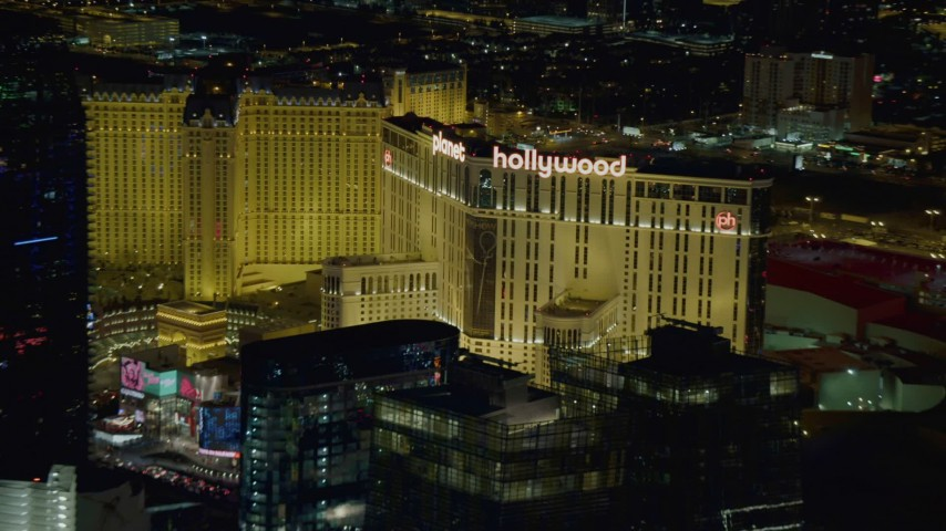 4K stock footage aerial video of zooming in on Planet Hollywood Resort and Casino, Las Vegas, Nevada Night Aerial Stock Footage DCA03_214 | Axiom Images