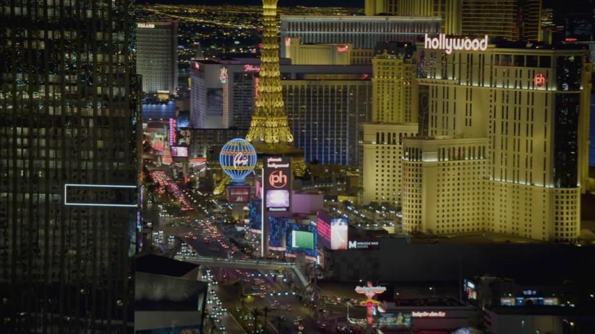 4K aerial video of flying by Mandarin Oriental, revealing hotels on Las Vegas Boulevard, Nevada Night Aerial Stock Footage DCA03_215