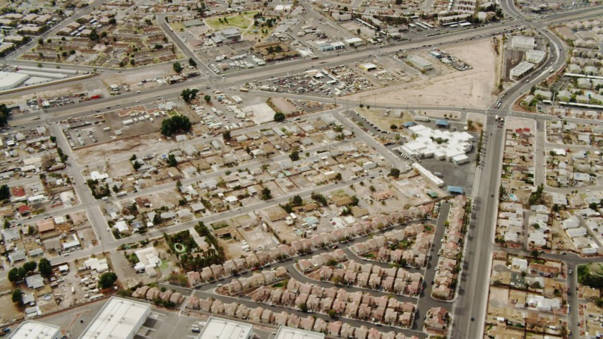 4K stock footage aerial video flying over suburbs and warehouses in East Las Vegas, Nevada Aerial Stock Footage | DCA04_003