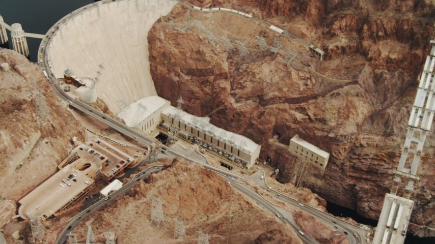 4K stock footage aerial video of panning across Colorado River, revealing Hoover Dam, Boulder City, Nevada Aerial Stock Footage | DCA04_008