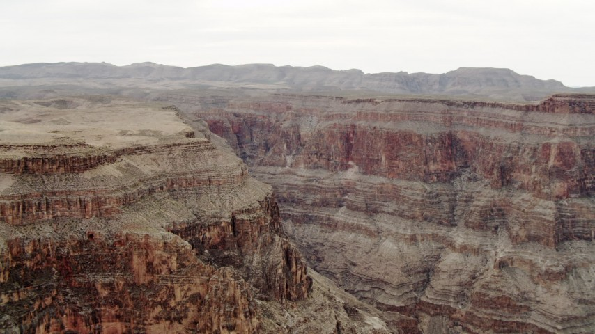 4K stock footage aerial video of flying by jagged cliffs in Grand Canyon, Arizona Aerial Stock Footage | DCA04_030